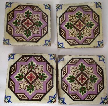 Quatro azulejos policromados